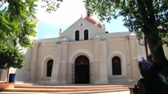 People visit the historical church in Santo Cerro, Dominican Republic. Stock Footage