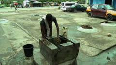 ADEISO GIRL PULLS BUCKET OF WATER FROM WELL - stock footage