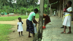 ADEISO MOTHER BRINGS YOUNG GIRLS TO SCHOOL Stock Footage
