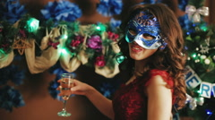 Drinking champagne at New Year's Eve a beautiful lady Stock Footage