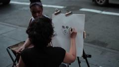 Street Artist Drawing a Portrait Stock Footage