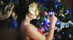 Beautiful sexy lady in the mask drinking champagne Stock Footage