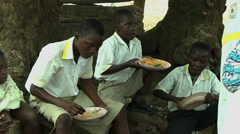 ADEISO SCHOOL LUNCH: BOY STUDENTS EAT Stock Footage