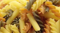 Rotated uncooked Italian macaroni pasta - stock footage