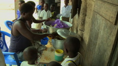ADEISO SCHOOL LUNCH: WOMEN SERVING FOOD 2 Stock Footage