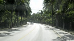View from a car passing by the road in Punto Cana, Dominican Republic. Stock Footage