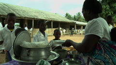 ADEISO SCHOOL LUNCH: WOMAN SERVES STUDENTS SCHOOL IN BG Arkistovideo