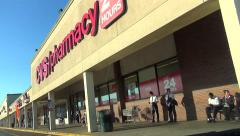 Shopping center stores, strip mall drive by Stock Footage