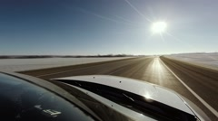 A white car driving with high speed on snow road Stock Footage