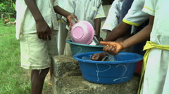 CLOSE UP: ADEISO BOY STUDENTS WASH DISHES Stock Footage
