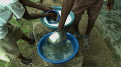 CLOSE UP: ADEISO STUDENTS WASH DISHES Stock Footage