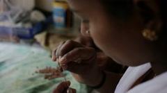 Indian Woman Preparing Beads ForHandmade Clay Jewellery Stock Footage