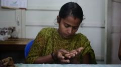 Indian Girl Rolling Handmade Clay Jewellery in her Hand Stock Footage
