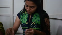 Indian Woman Making Handmade Clay Jewellery Beads Stock Footage