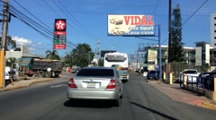 Cars passing by the street of Francisco de Macoris, Dominican Republic. Stock Footage