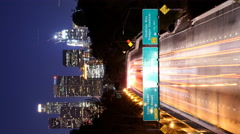 Time Lapse of Urban Highway Light Streaks in LA at Night -Vertical/Tilt Down- Stock Footage