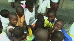 GROUP OF ADEISO STUDENTS WASH DISHES Stock Footage