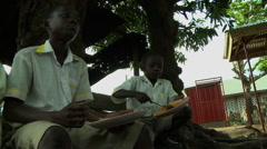 LOW ANGLE: BOY STUDENTS EAT LUNCH AT ADEISO SCHOOL Stock Footage