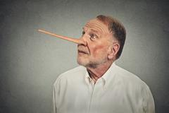 Man with long nose looking up. Liar concept Stock Photos
