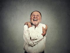 Smiling man holding hugging himself Stock Photos