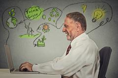 senior man working on computer solving ecology problems - stock photo