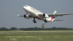 Emirates airplane take off, from side view Stock Footage