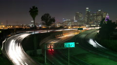 Time Lapse of Traffic on I-10, the 101 and the Los Angeles California skyline Stock Footage
