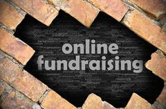 Hole in the brick wall with word online fundraising - stock photo