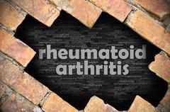 Hole in the brick wall with word rheumatoid arthritis - stock photo