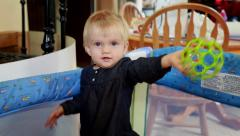 Beautiful baby girl holding toy Stock Footage