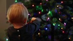Toddler decorating Christmas tree - stock footage