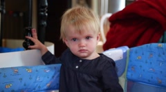 Baby girl looking at camera, frowning face - stock footage