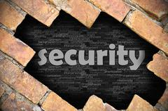 Hole in the brick wall with word security - stock photo