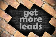 Hole in the brick wall with word get more leads Stock Photos