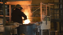 VOTKINSK RUSSIA - MAY 2014: worker controlling iron smelting in factory Stock Footage