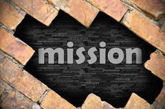 Hole in the brick wall with word mission - stock photo