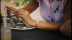 2902 - steam clams at the picnic with friends - vintage film home movie Stock Footage