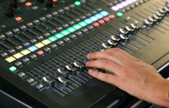 big mixing console with channel to change volume and bass and treble - stock photo