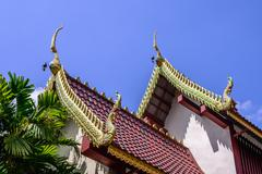 Beautiful gable apex on the roof of buddhist temple. Stock Photos