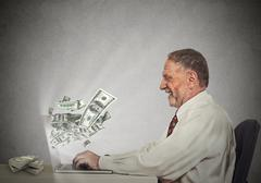 Smiling business man working online on computer earning money Stock Photos