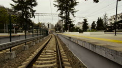 High-speed train rides the rails to the resort on the Black Sea Coast Stock Footage