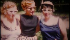 2904 - fashionable women model their clothing - vintage film home movie Stock Footage