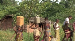 Baka people vilage life carry water on head. Stock Footage