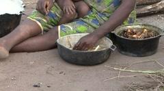 Baka people vilage life cocking food. Stock Footage