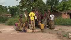 Baka people vilage life collecting water from well. Stock Footage