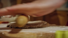 Christmas cookies, rolling dough with a rolling pin Stock Footage