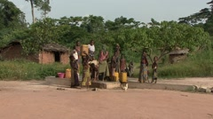 Baka people vilage life collecting water from well. - stock footage