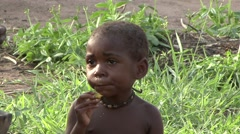 Baka people vilage life young girl eating. Stock Footage