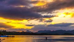 Timelapse Heavenly Sunset. Cheow Lan Lake or Rajjaprabha Dam Reservoir, Thailand Stock Footage