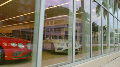 Car dealership with cars in a showroom Stock Footage